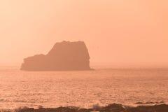 stor kustsolnedgångsur Arkivbild