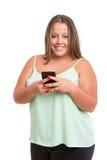 Stor kvinna på telefonen arkivfoton