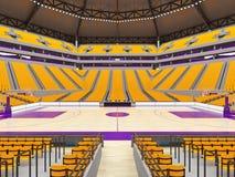 Stor modern basketarena med gula platser Arkivbilder