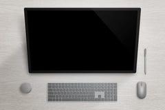 Stor pekskärmskärm på grå färgyttersidabräde Penna, mus, tangentbord och visartavla beside Royaltyfri Fotografi