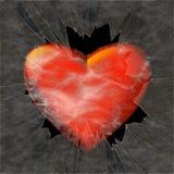 Stor röd hjärta bak splittrat exponeringsglas Arkivbild