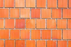 Stor röd tegelstenvägg Arkivfoton