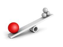 Stor röd ledare Sphere On Balance med den vita gruppen Arkivbild