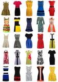 Stor samling av stilfulla kvinnaklänningar som isoleras på vit Royaltyfri Foto