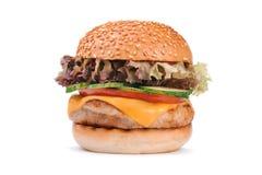 Stor smaklig hamburgare för barnhönahamburgare som isoleras på vit Arkivbild