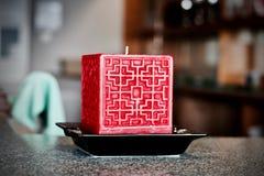 Stor stearinljus för röd fyrkant Royaltyfri Bild
