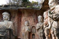 Stor stenBuddha på stenväggen på Wuxi Yuantouzhu - Taihu landskapträdgård, Kina Arkivbild