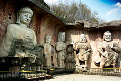 Stor stenBuddha på stenväggen på Wuxi Yuantouzhu - Taihu landskapträdgård, Kina Royaltyfria Bilder