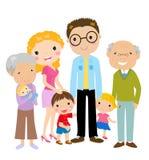 Stor tecknad filmfamilj med föräldrar, barn och gran Arkivbilder