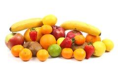 Stor uppsättning av olika frukter på vit bakgrund Fotografering för Bildbyråer