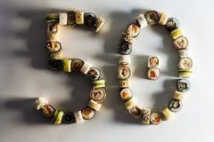 stor uppsättning med sushi och rullar royaltyfria bilder