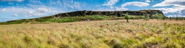 Stor Wanney brant klippapanorama Arkivfoton