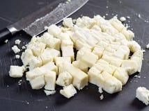 Stora bitar av Paneer ost arkivfoton
