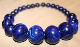 Stora blåttpärlor Arkivfoto