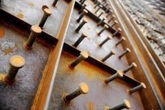 Stora bultar på en stålvägg Royaltyfria Bilder