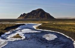 Stora- Dimon à travers le delt volcanique plat de vase et de cendre de Markarfljot, Islande Image libre de droits