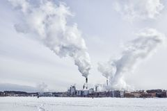 Stora Enso Imatran Paper Mill Finland saimaa lake winter. Blue sky stock image