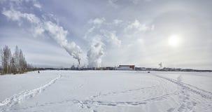 Stora Enso Imatran Paper Mill Finland saimaa lake winter. Blue sky royalty free stock photo