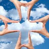 stora isolerat medicinskt symbol för kors händer Royaltyfria Bilder