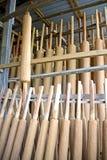 Stora josssticks i fabrik arkivbild
