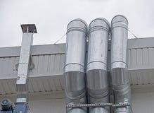 Stora skinande metallrör Royaltyfri Bild