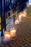 Stora stearinljus i exponeringsglas Royaltyfria Foton