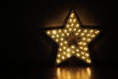 Stora stjärna och massor av ljusa kulor fotografering för bildbyråer
