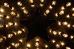 Stora stjärna och massor av ljusa kulor arkivbilder