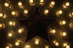 Stora stjärna och massor av ljusa kulor royaltyfri fotografi