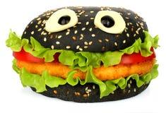 Stora svarta roliga ögon för hamburgarewhithost royaltyfri bild