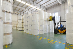 Storage area. A worker was driving a fork-lift truck in storage area of warehouse of a moving and storage company in Minhang distirict, Shanghai Stock Photos