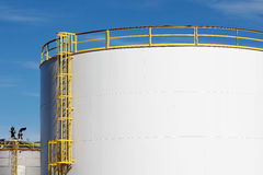 Storage Bin. Abstract view of yellow ladder and railing on white storage bin at ethanol plant in midwest royalty free stock photography