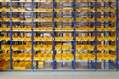 Storage bins. Storage trays and bins in distribution warehouse stock photo