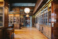 Storage of books. Large old library in the Gothic style. Shelves and rows with books. City Library at the City Hall of Denmark royalty free stock photo