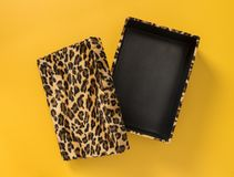 Storage box with classic leopard print. On bright yellow background stock photo