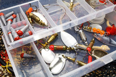 Storage box with fishing baits and accessories Stock Images