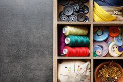 Storage box with set of tailoring items on table,. Top view stock photography
