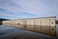 Storage building is partly underwater Royalty Free Stock Image