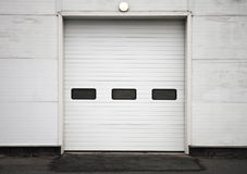 Storage building wall with closed gate Royalty Free Stock Photography