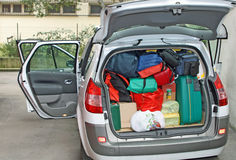 Storage of a car full of family Stock Images