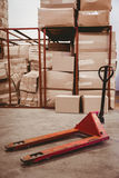 Storage cart on floor in warehouse Royalty Free Stock Images