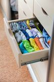 Closet with children`s things. Storage of children`s clothes. stock photo