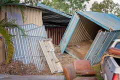 A Storage Container After Flood Waters Recede. A large storage container pushed onto it`s side by the force of flood waters royalty free stock image