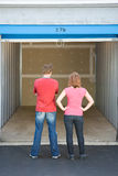 Storage: Couple Looking at Empty Unit royalty free stock photo