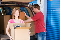 Storage: Couple Taking THings to Storage Unit Royalty Free Stock Images