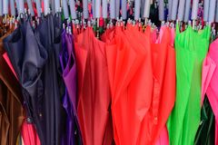 Storage of different colors umbrella. Colorful umbrellas background. royalty free stock photo