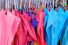 Storage of different colors umbrella. Colorful umbrellas background. royalty free stock photography