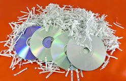 Storage discs and shredded paper sheets Royalty Free Stock Photography