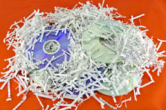 Storage discs and shredded paper sheets Stock Photos