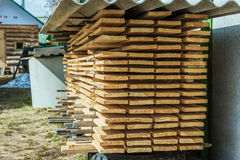 Storage edged boards stacked in the country. Storage and natural drying edged board outdoors Stock Images